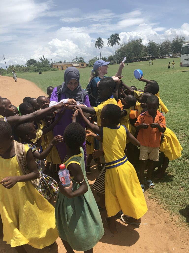Mariam plays with a group of kids in Ghana