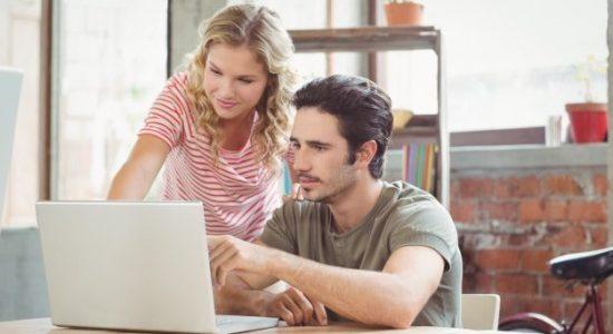 man-woman-working-laptop-office_13339-167163